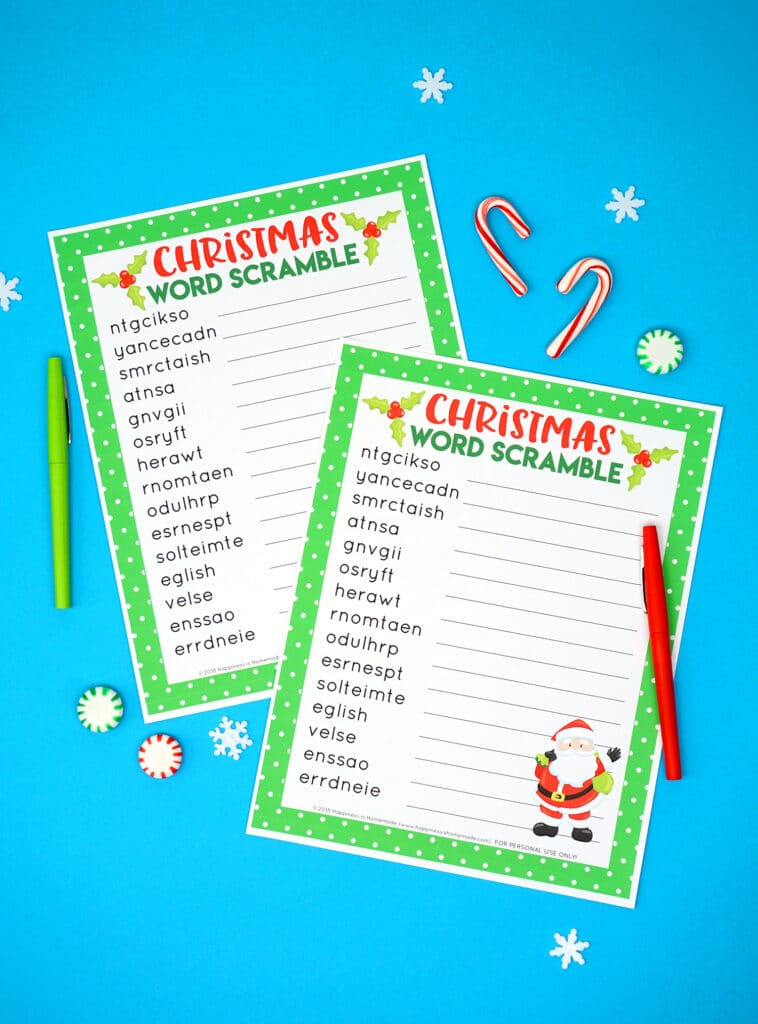 printable christmas word scramble on a blue background with pens and candy canes