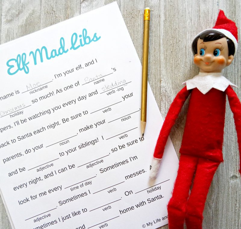 printable elf mad libs on a wooden background next to a pencil and an elf doll