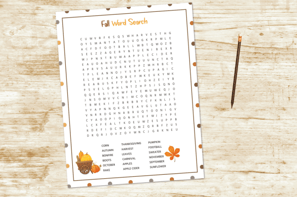 Fall word search worksheet on desk next to pencil