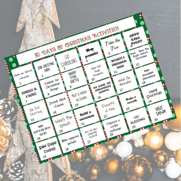 30 days of family Christmas activities printable on a gray background with ornaments and pinecones