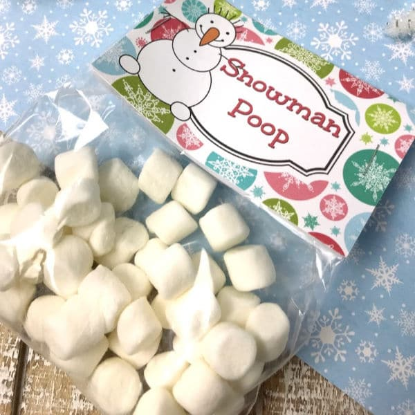 a plastic bag of marshmallows with the label Snowman Poop on brown and blue linens