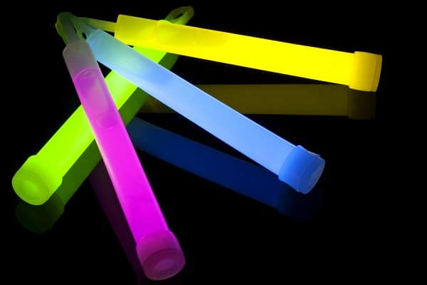 green, pink, blue and yellow glowsticks on a black background
