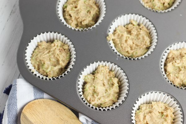 healthy chocolate chip muffins batter in muffin cups in a muffin tin