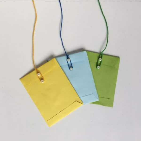 yellow, blue and green mini envelopes on a white background
