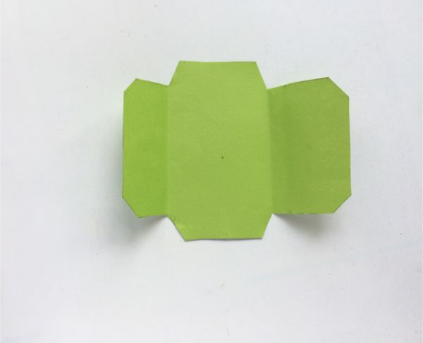 unfolded green envelope from template on a white background