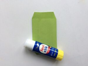 glue stick and a small green envelope
