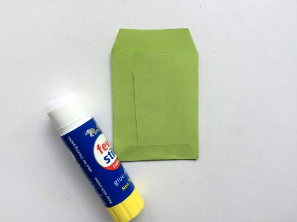 how to glue a diy mini envelope on a white background