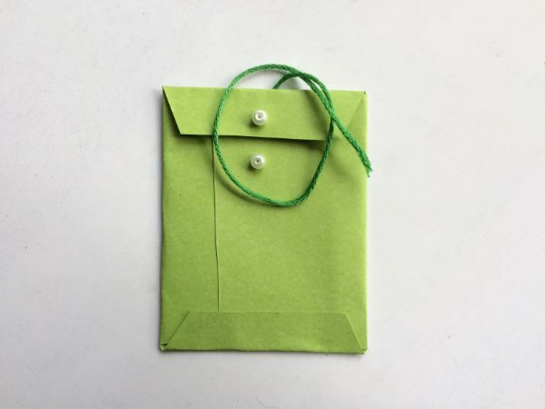 green mini envelope on a white background