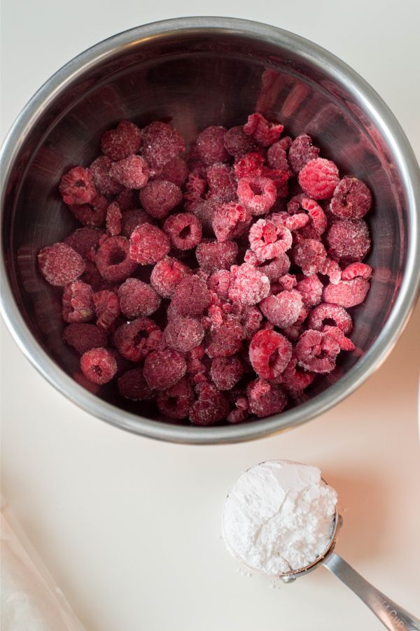 raspberries in a bowl with sugar