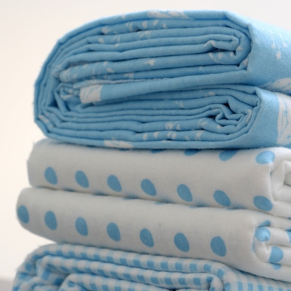 folded stack of bed linens