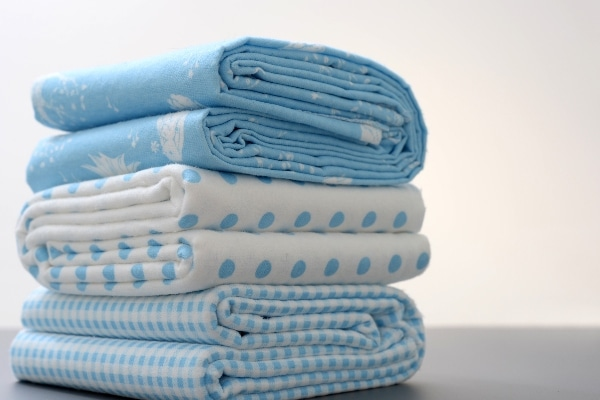 close up shot of blue patterned bed sheets to represent other uses for bed sheets