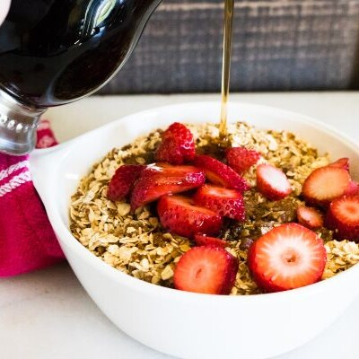 Amish Baked Oatmeal Topped with Strawberries with syrup being pored on top