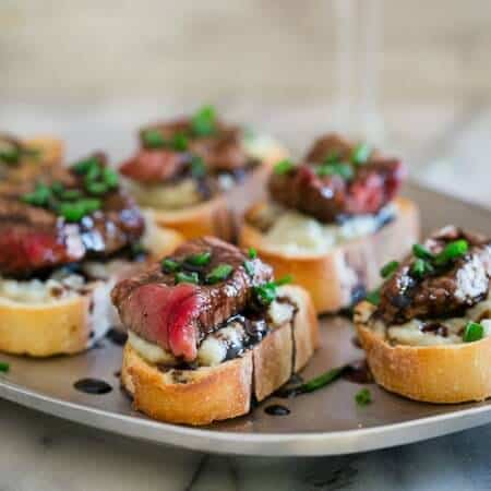 blue cheese steak crostini on a silver tray