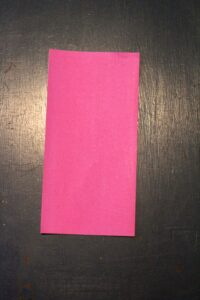 pink origami paper folded in half