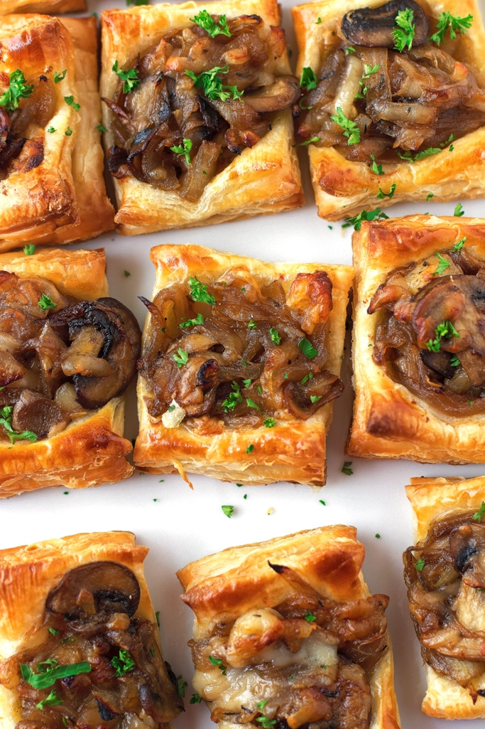 puff pastry with mushrooms and cheese on it on a white background
