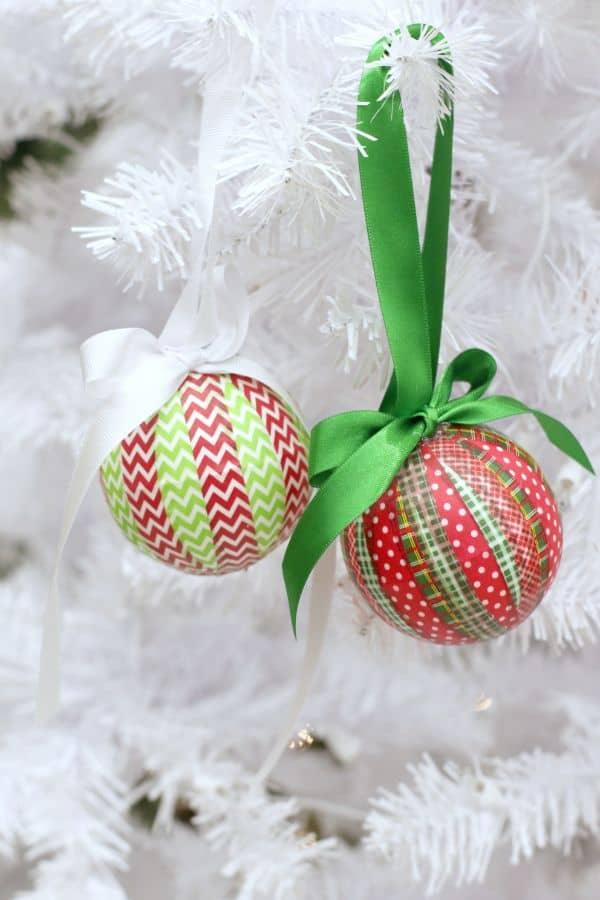 These DIY Washi Tape Ornaments are so colorful and easy to customize simply by choosing different tape. Now there's no reason to resist that washi tape clearance bin when you're at the craft store! #ornaments #christmas #diy #washitape via @wondermomwannab