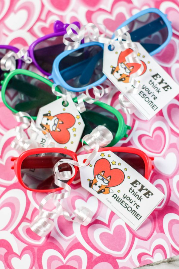 "These Sunglasses Valentines are a fun and easy non-candy Valentine idea! Punny cute, and inexpensive. Party favor sunglasses turn into a memorable Valentine gift with the free printable ""Eye Think You're Awesome"" card attached! #valentine #printable #noncandy via @wondermomwannab"