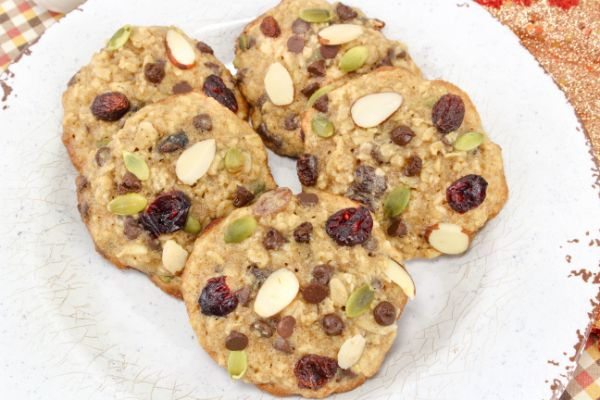 Five Trail mix cookies arranged on a white plate