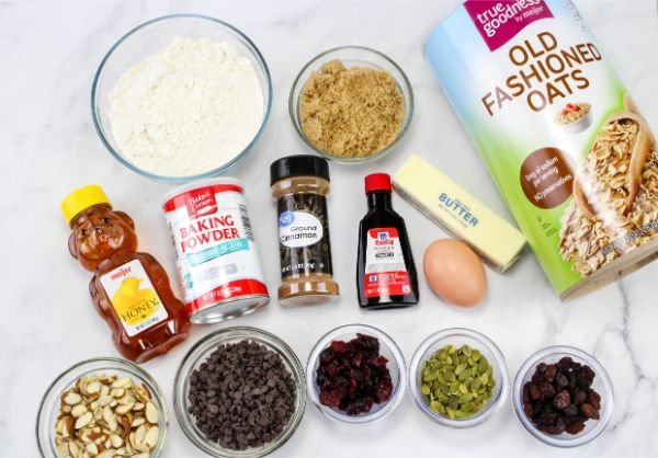 Ingredients for trail mix cookies on marble countertop