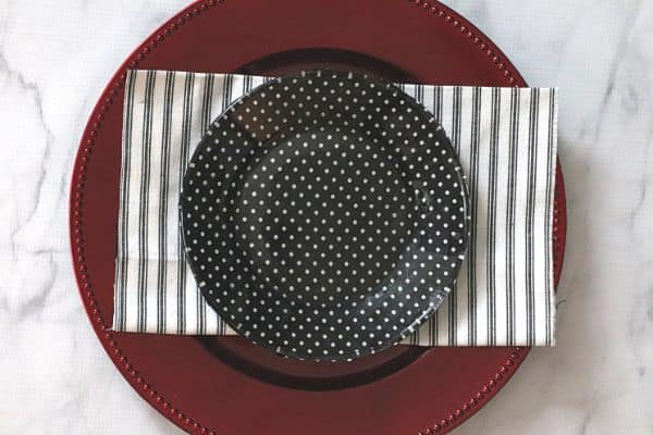 a black and white cake plate on black and white babric on a red plate