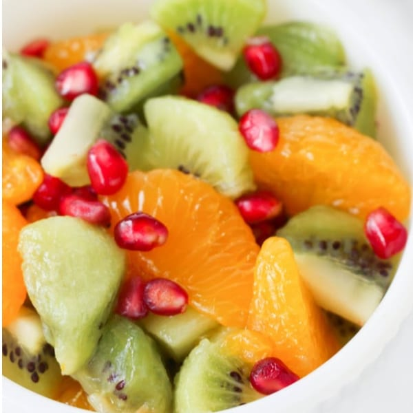 a close up of Kiwi Fruit Salad in a white bowl