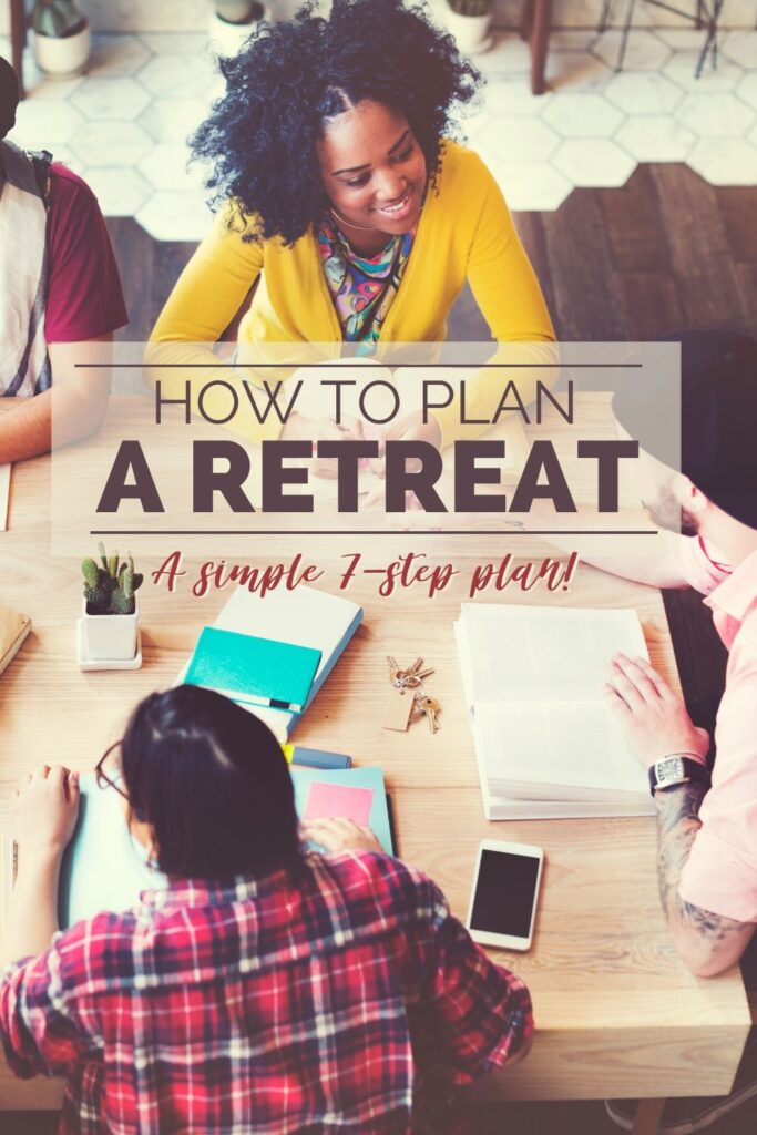 people gathered around a table with papers and a phone on the table with title text reading How To Plan A Retreat A simple 7 step plan
