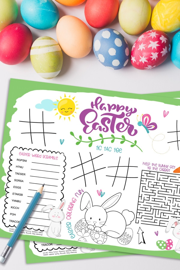 printable Easter placemat with a pencil on it, next to dyed Easter eggs