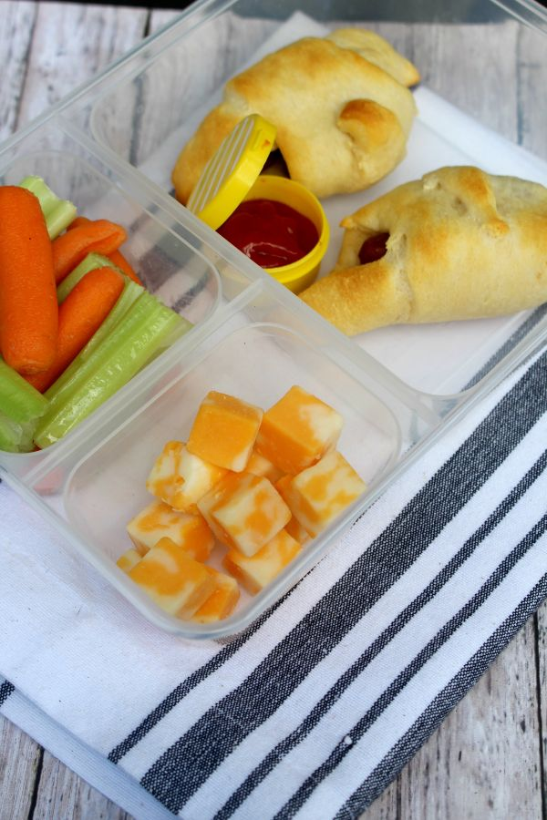 pigs in a blanket lunch box with cubed cheese and carrots and celery