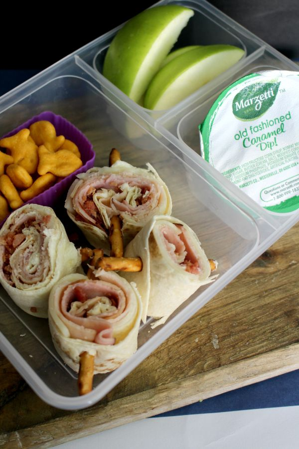 pinwheel lunch box with goldfish, apple slices and caramel dip