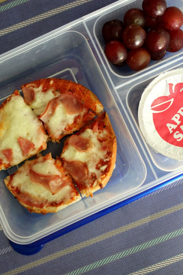 pizza bagel lunch box also with grapes and apple sauce