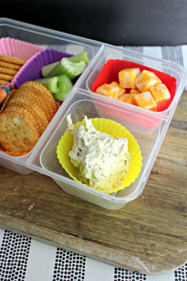tuna salad lunch box with cubed cheese, crackers and celery