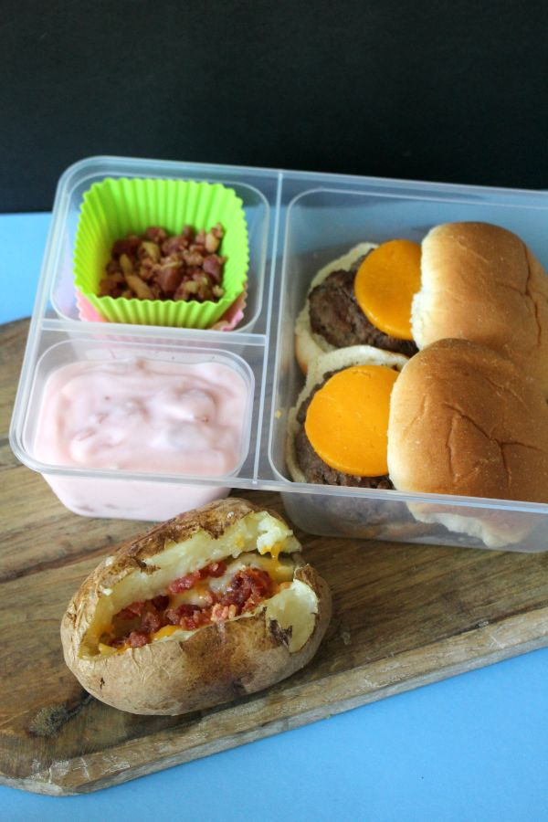 slider lunch box also with yogurt and a baked potato