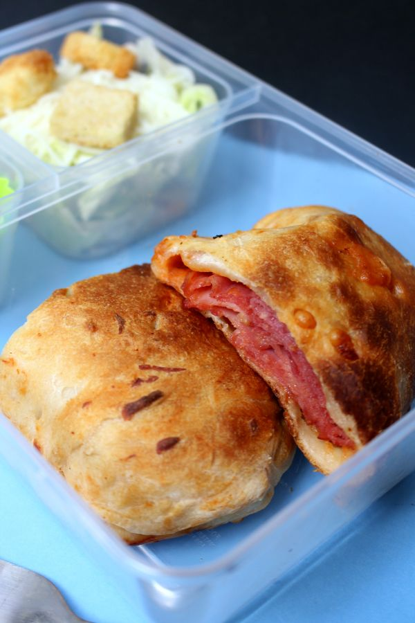 stromboli lunch box also with a salad
