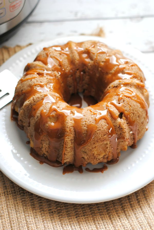 Instant Pot Caramel Apple Bundt Cake on a white plate on a brown mat