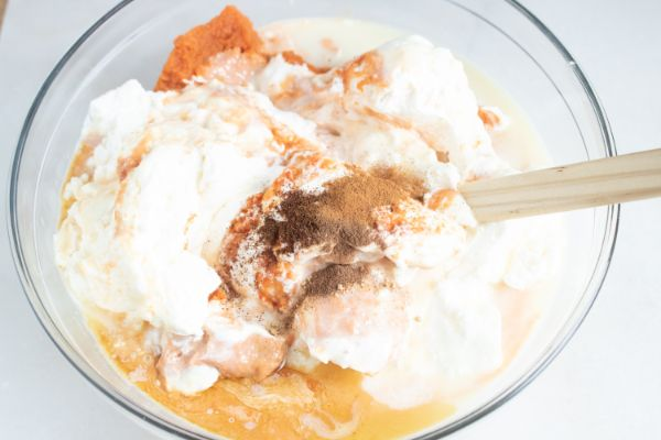 making no churn pumpkin pecan ice cream in a glass bowl