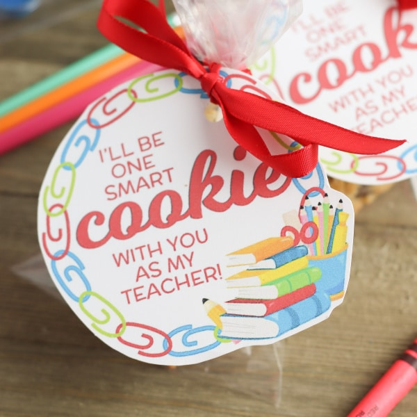 One Smart Cookie Teacher Gift printable tag with a red ribbon tied on it