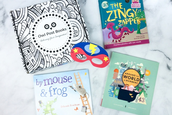 3 books next to a box from owl post books, one of The 17 Best Monthly Book Clubs for Kids