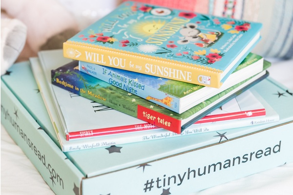a box with books on top of it from tiny humans read, one of The 17 Best Monthly Book Clubs for Kids