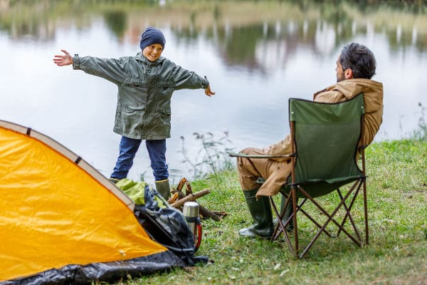 camping as a family near the water