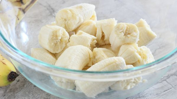 bananas in a glass bowl before they are mashed