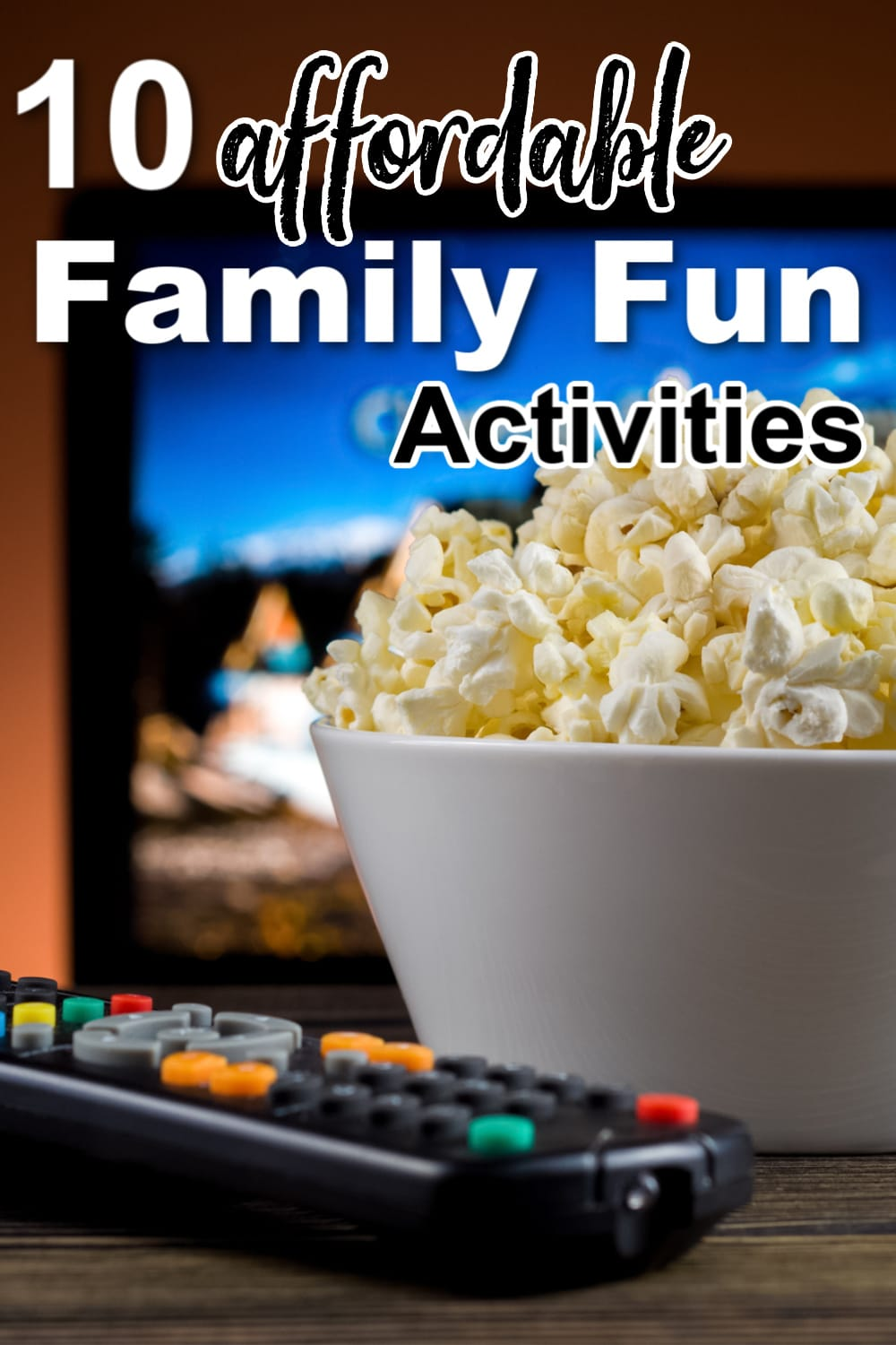 a white bowl of popcorn next to a tv remote with a tv in the background with title text reading 10 affordable Family Fun Activities