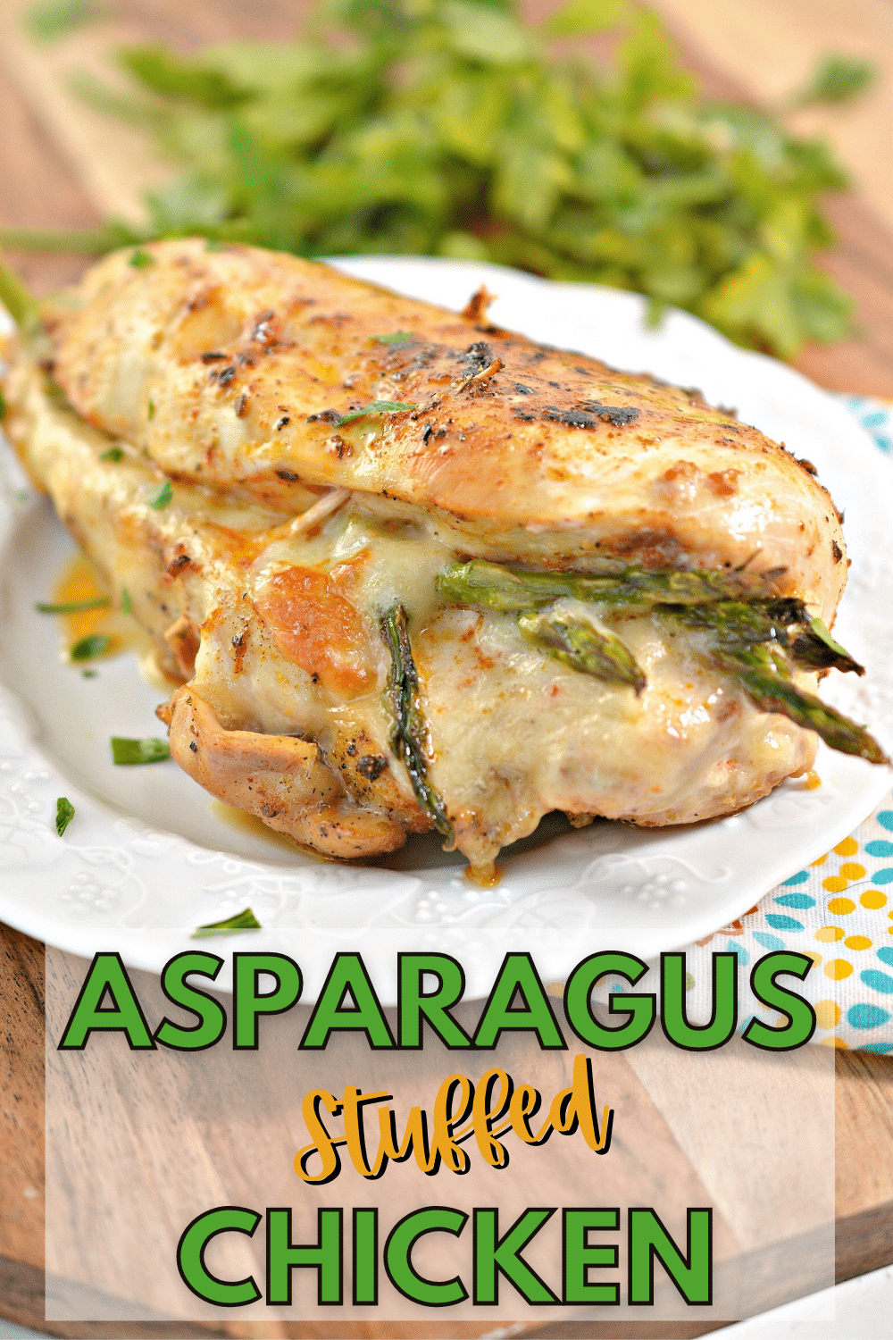 Asparagus Stuffed Chicken is an elegant and low carb dinner recipe that is perfect for guests. The flavors of asparagus, seasonings and chicken is divine. #asparagus #chicken #lowcarb via @wondermomwannab
