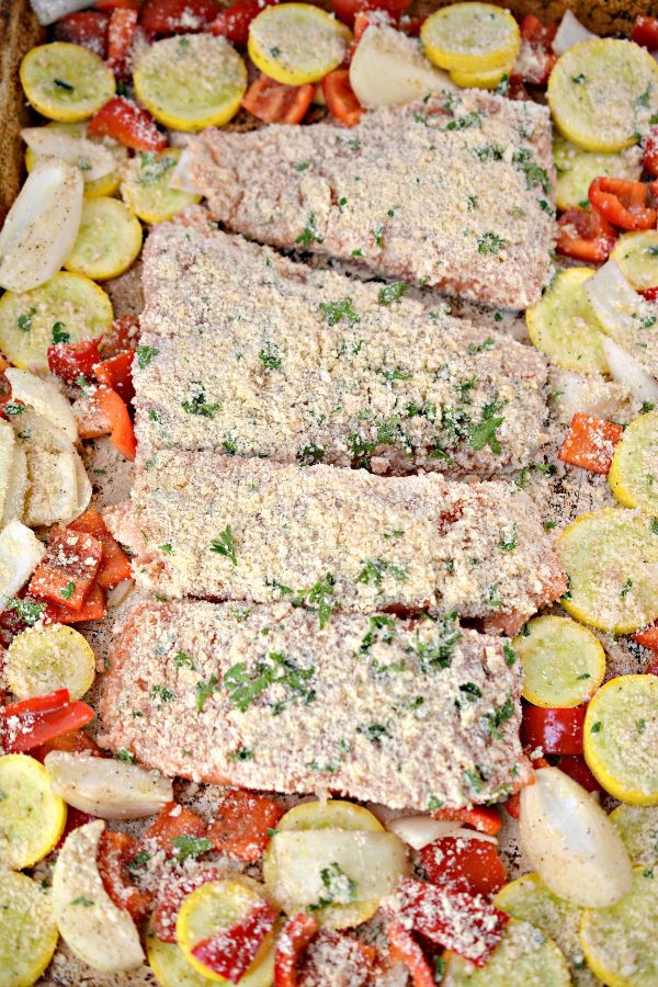 Keto Parmesan Crusted Baked Salmon and vegetables on a sheet pan ready to bake