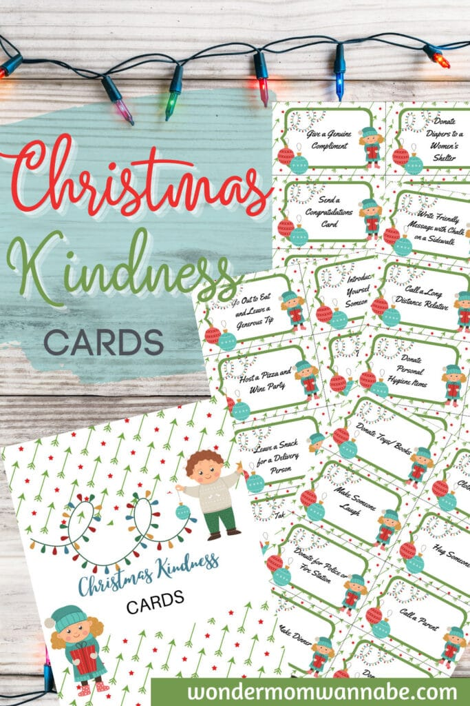 printable Christmas kindness cards on a wood background with a string of Christmas lights and title text reading Christmas Kindness Cards