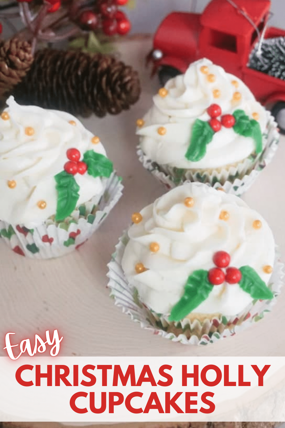 How absolutely adorable and fun are these easy Christmas holly cupcakes?! They're such an easy Christmas cupcake that you can have them decorated in about 10 minutes. #hollycupcakes #christmascupcakes via @wondermomwannab