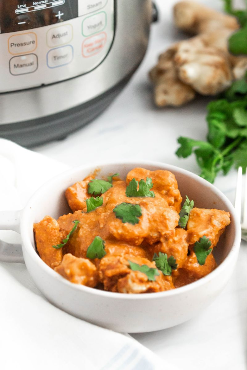 Instant pot Chicken Tikka Masala is a rich and creamy Indian recipe that is spicy and flavorsome! Tasting better than takeout, it's finger licking delicious! You'll be going back for seconds! #chickentikkamasala #instantpotdish #onepotdish #indianrecipes #homemadechickentikka #easychickentikka #instantpotchickentikka #restaurantstyle #tikkamasala #bestchickentikka #indianfood via @wondermomwannab
