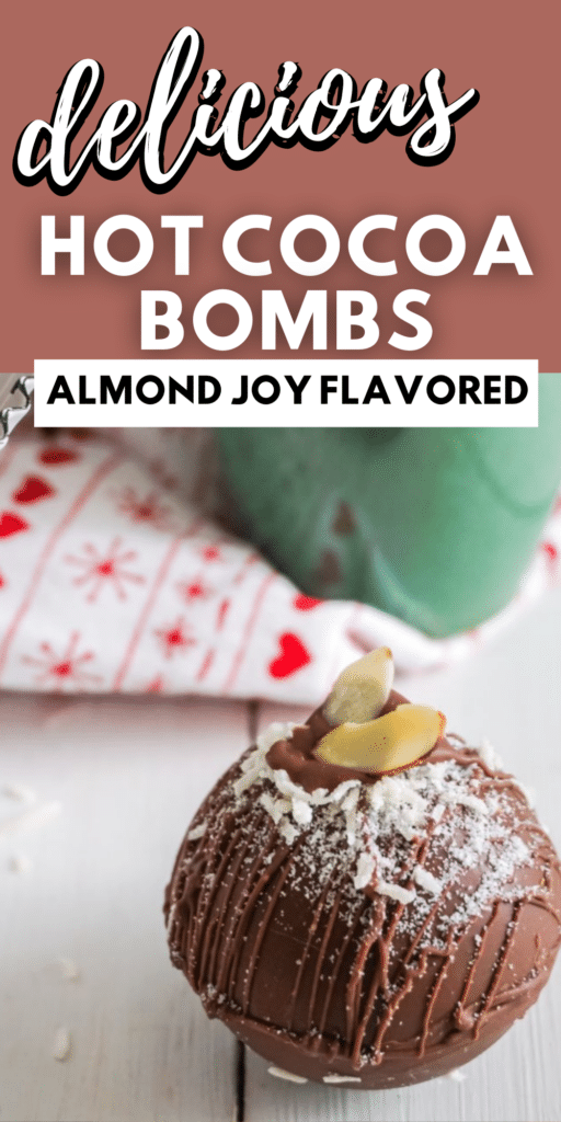 close up of an almond joy hot cocoa bomb with a red and white cloth and green mug in the background with title text overlay reading delicious Hot Cooca Bombs Almond Joy Flavored