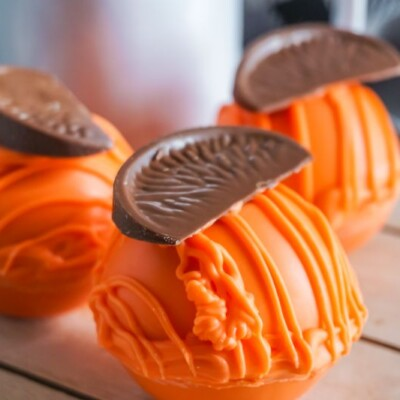 Chocolate Orange Hot Cocoa Bombs on wooden platter