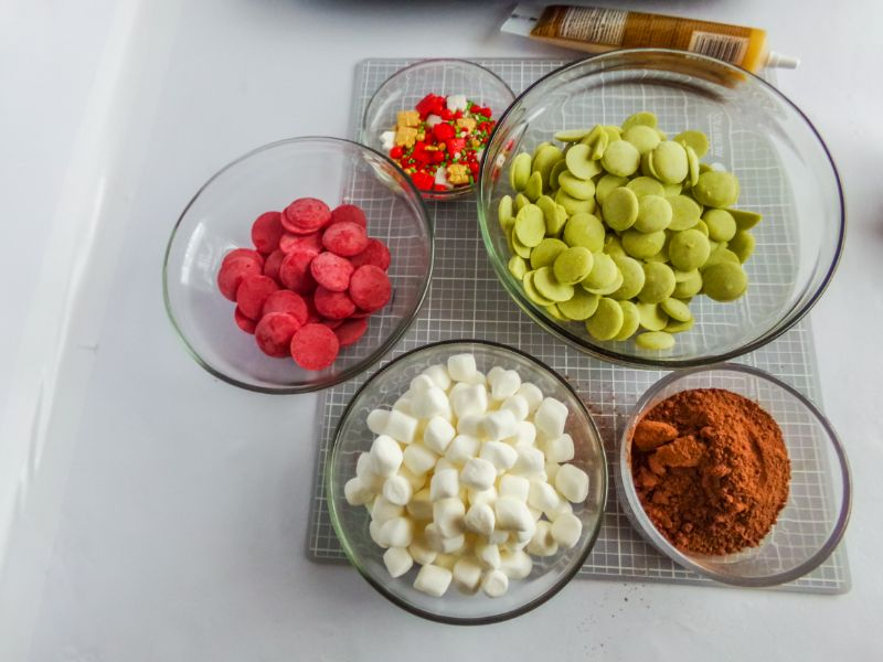glass bowls of ingredients needed for Christmas Hot Cocoa Bombs