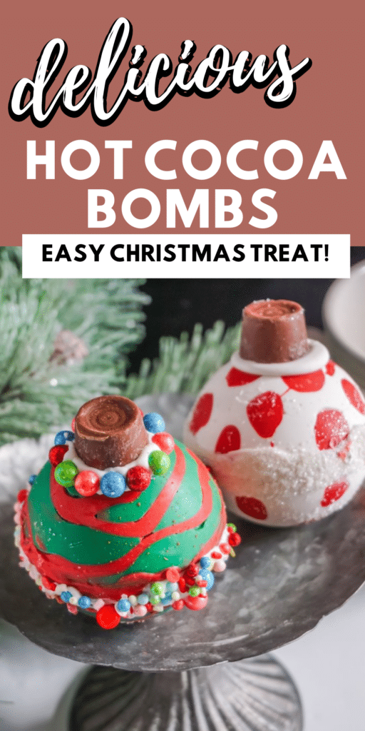 Christmas Ornament Hot Cocoa Bombs  on metal stand with part of a Christmas tree in the background with title text reading delicious Hot Cocoa Bombs Easy Christmas Treat